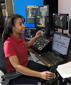 photo: stephanie wilson at technical equipment console